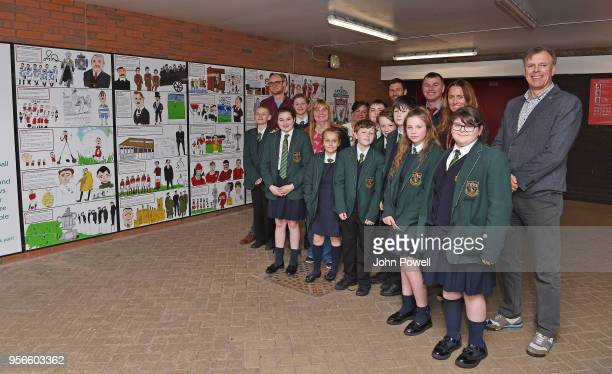 Pictured are local school children with artist David Andrews Margaret Aspinall chairman of the Hillsborough family support group and Stephen Done LFC...