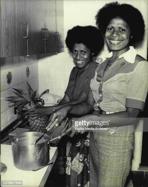 Pictured are two Fijian nurses at their home in Leichhardt getting ready their first evening meal after being released from prison where they have...
