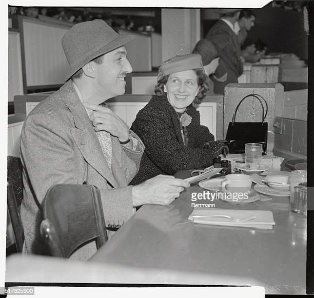 Pictured at the races at Santa Anita track recently are Mr and Mrs Walt Disney They are seen in the Turf Club at the track