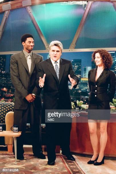 Baskbetall player Kobe Bryant host Jay Leno and actress Kim Delaney pose for a photo on February 12 1998