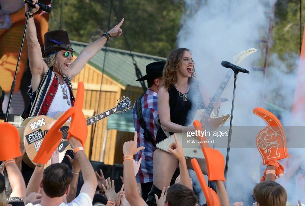 Big Kenny of Big & Rich and Halestorm's Lizzie Hale on the set of 'ESPN GameDay' opening taping as Big & Rich, Cowboy Troy, Lizzie Hale and Travie McCoy perform at The Woods Amphitheater at Fontanelon May 7, 2014 in Nashville, Tennessee.