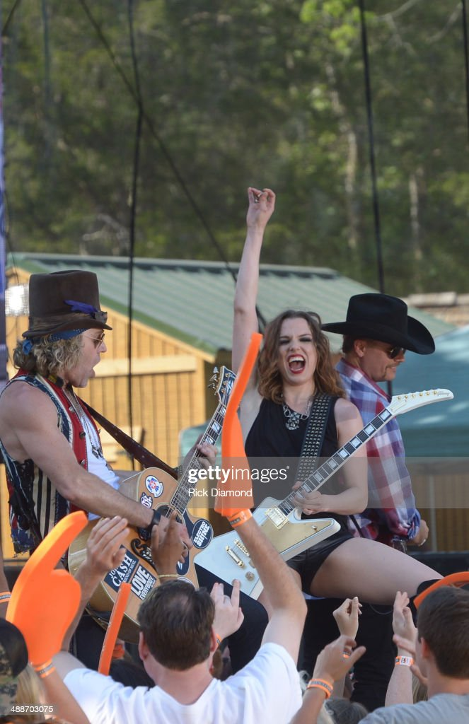 Big & Rich's Big Kenny and John Rich are joined by Halestorm's Lizzie Hale (center) on the set of 'ESPN GameDay' opening taping as Big & Rich, Cowboy Troy, Lizzie Hale and Travie McCoy perform at The Woods Amphitheater at Fontanelon May 7, 2014 in Nashville, Tennessee.