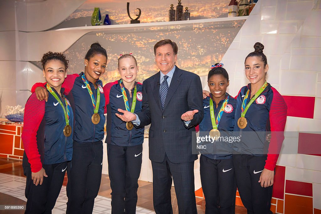 Bob Costas (center) poses with U.S. Gymnasts (l-r) Laurie Hernandez, Gabby Douglas, Madison Kocian, Simone Biles, and Aly Raisman on August 9, 2016 --
