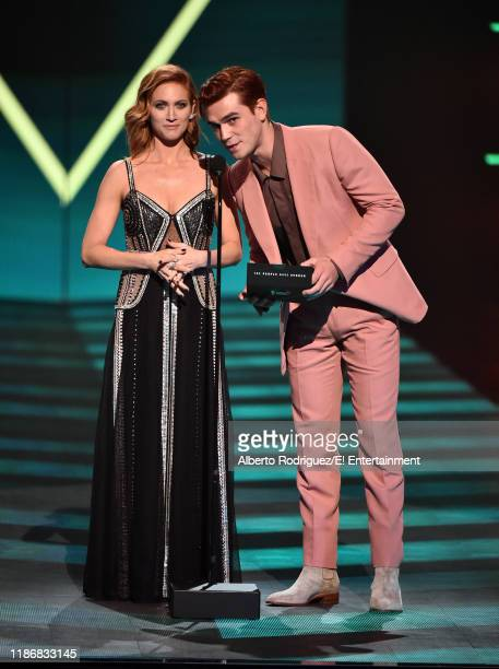 Brittany Snow and KJ Apa speak on stage during the 2019 E People's Choice Awards held at the Barker Hangar on November 10 2019 NUP_188997
