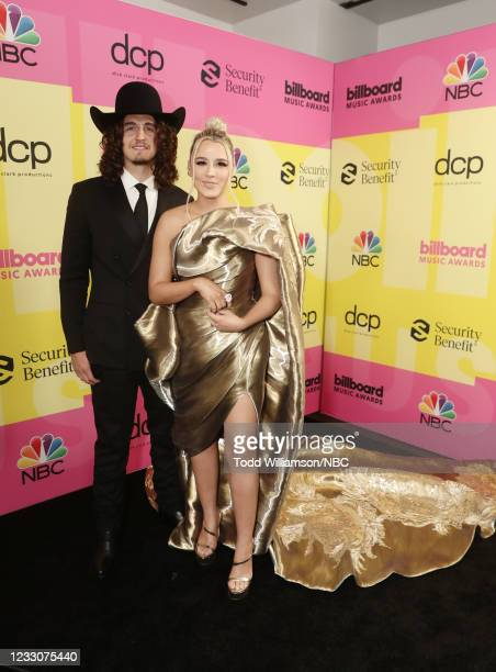 Pictured: Cade Foehner and Gabby Barrett arrive to the 2021 Billboard Music Awards held at the Microsoft Theater on May 23, 2021 in Los Angeles,...