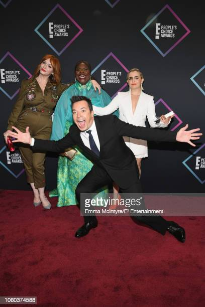 Christina Hendricks Retta and Mae Whitman get photobombed by Jimmy Fallon as they arrive to the 2018 E People's Choice Awards held at the Barker...