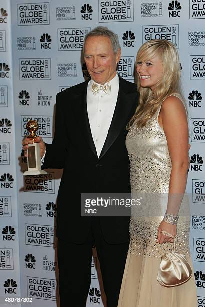 Clint Eastwood winner of the award for Best Director of a Motion Picture for 'Million Dollar Baby' and Miss Golden Globe Kathryn Eastwood pose in the...
