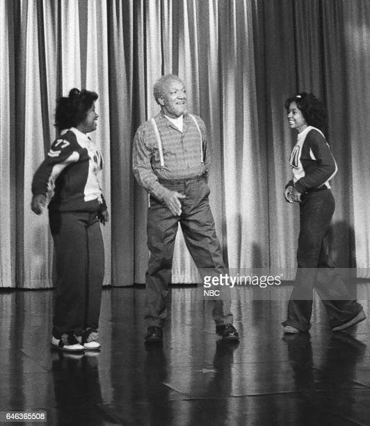 Comedian Redd Foxx performing a cheer routine with cheerleaders on October 16th 1975