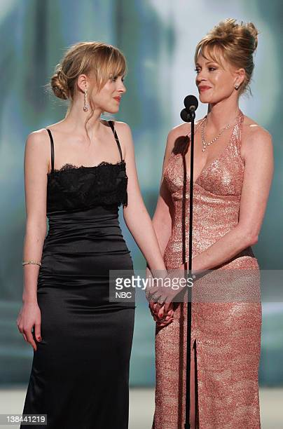 Dakota Johnson Miss Golden Globe and Melanie Griffith on stage during The 63rd Annual Golden Globe Awards at the Beverly Hilton Hotel