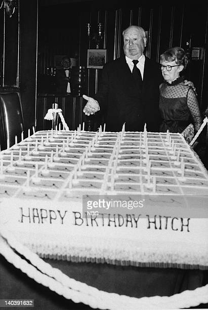 Pictured: Director, Alfred Hitchcock and his wife, Alma, celebrating his 75th birthday in 1974 -- Photo by: NBCU Photo Bank