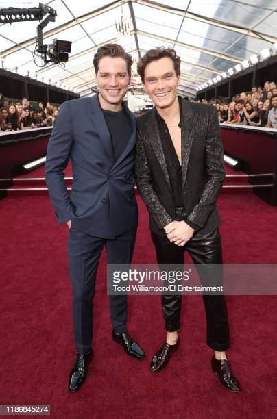 Pictured: Dominic Sherwood and Luke Baines arrive to the 2019 E! People's Choice Awards held at the Barker Hangar on November 10, 2019. -- NUP_188990