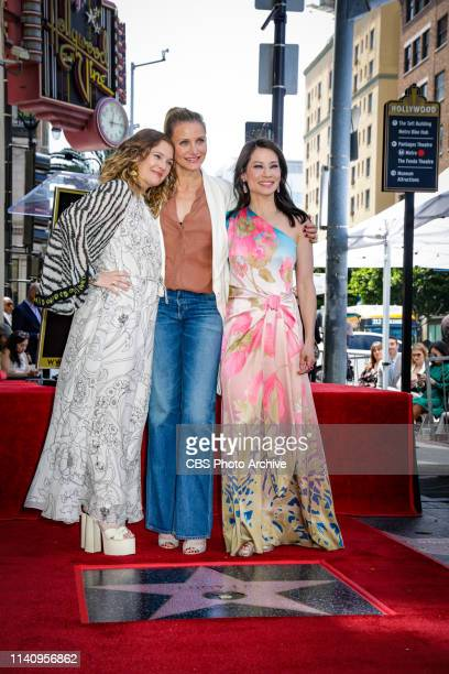 Pictured Drew Barrymore, Drew Barrymore and Lucy Liu, and pose with Lucy Liu's star on the Hollywood Walk of Fame on May 1, 2019.