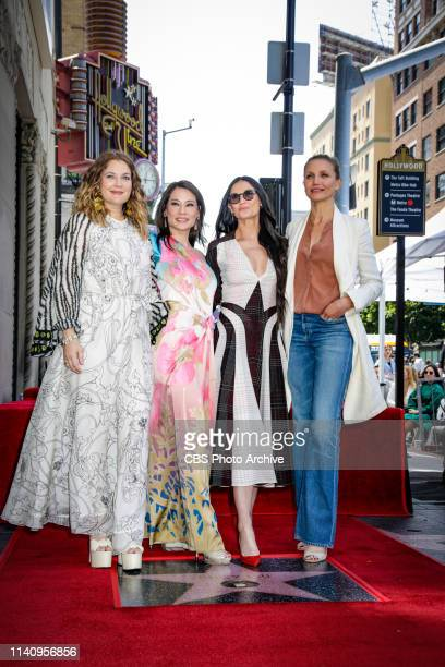 Pictured Drew Barrymore Lucy Liu Demi Moore and Cameron Diaz pose with Lucy Liu's star on the Hollywood Walk of Fame on May 1 2019