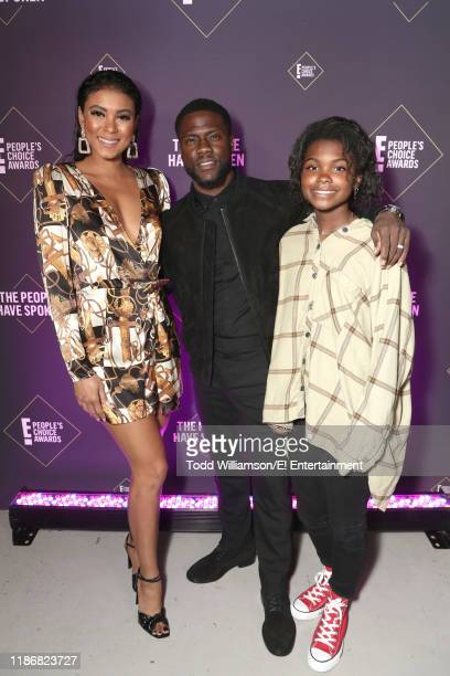 Eniko Parrish Kevin Hart and Hendrix Hart pose backstage during the 2019 E People's Choice Awards held at the Barker Hangar on November 10 2019...