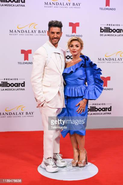 Erick Elías and his wife Karla Guindi on the red carpet at the Mandalay Bay Resort and Casino in Las Vegas NV on April 25 2019