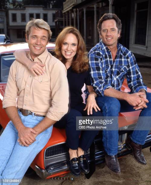 Pictured from left is John Schneider , Catherine Bach , Tom Wopat , in the made for television movie, THE DUKES OF HAZZARD: REUNION!. Air date April...