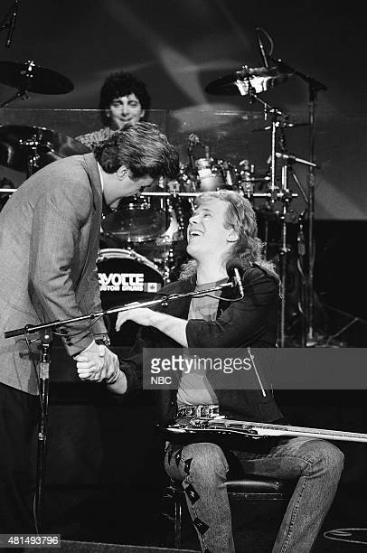 Pictured: Guest host Jay Leno and Jeff Healey of the musical guest The Jeff Healey Band on December 20, 1990 --