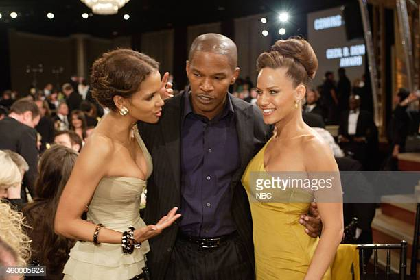 Halle Berry Jamie Foxx and Leila Arcieri attend the 62nd Annual Golden Globe Awards held at the Beverly Hilton Hotel on January 16 2005