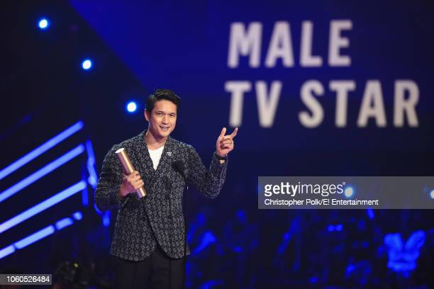 Harry Shum Jr accepts The Male TV Star of 2018 award for 'Shadowhunters' on stage during the 2018 E People's Choice Awards held at the Barker Hangar...