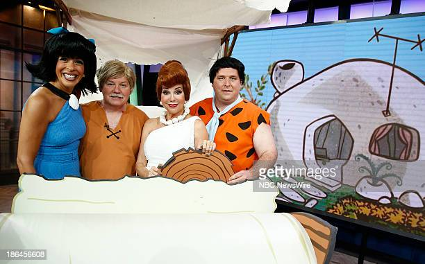 Hoda Kotb as Betty Rubble Gerry Ulrich as Barney Rubble Kathie Lee Gifford as Wilma Flintstone and Gerard Marrone as Fred Flintstone appear on NBC...