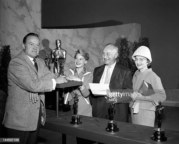 Host Bob Hope actress Hope Lange Academy Awards producer Arthur Freed actress Olivia de Havilland at the rehearsal for the 32nd Annual Academy Awards...
