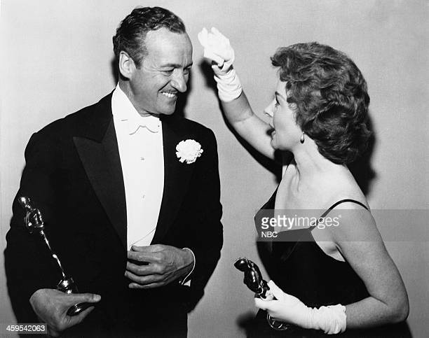 Host David Niven winner of Best Actor for Separate Tables Susan Hayward winner of Best Actress for I Want to Live during the 31st Annual Academy...