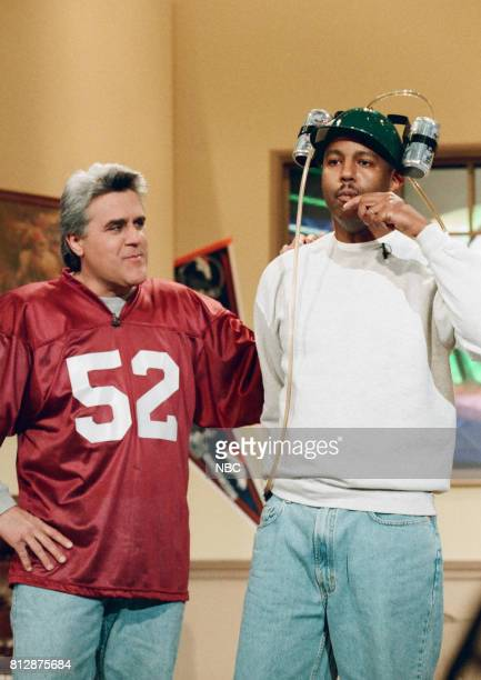 Host Jay Leno and musician Bob Hurst during 'Guy Living Super Bowl Party' segment on January 21 1998