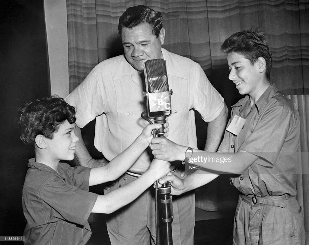 Host/baseball player Babe Ruth with young fans in 1944 --