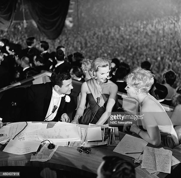 Hosts Frank Blair Dina Merrill actress Kim Novak covering the inaugural ball at the Inauguration of President John F Kennedy on January 20 1961 in...