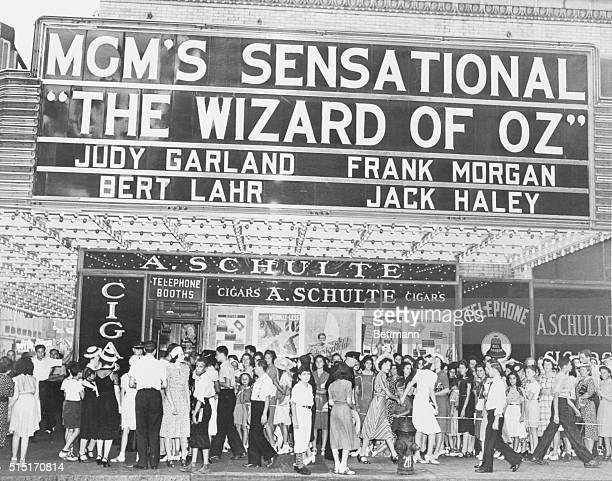 Pictured in front of the Capitol Theater on Broadway is part of the crowd of 10 mostly women and children who surrounded the entire block to wait in...