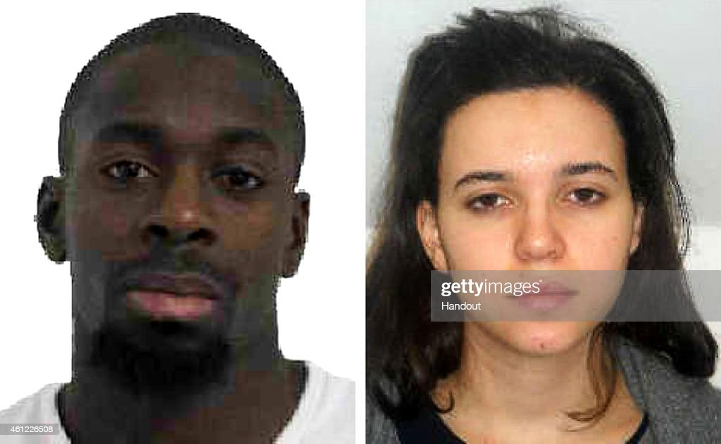 Pictured in this composite of handout photos provided by the Direction Centrale de la Police Judiciaire on January 9, 2015 are Amedy Coulibaly, aged 32, (L) who is wanted in connection with the shooting of a French policewoman yesterday and suspected as being involved in the ongoing hostage situation at a Kosher store in the Porte de Vincennes area of Paris, and known associate Hayat Boumeddiene, aged 26. France continues at the highest level of security alert following the attack at the satirical weekly Charlie Hebdo in which twelve people were killed on Wednesday. On January 8 French police published photos of two brothers, Said Kouachi and Cherif Kouachi, wanted as suspects over the massacre at the magazine.
