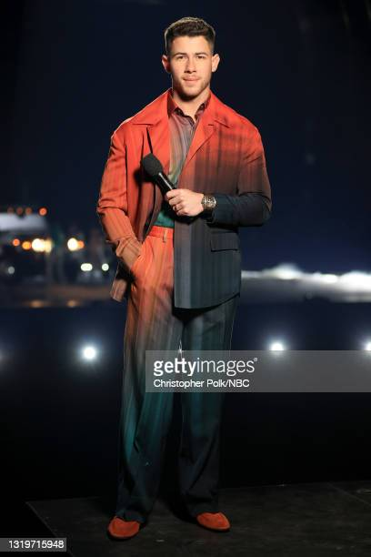 Pictured: In this image released on May 23, host Nick Jonas speaks on stage for the 2021 Billboard Music Awards, broadcast on May 23, 2021 at...