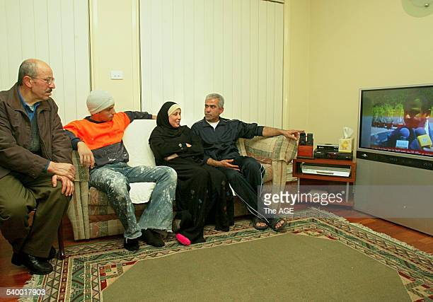 Pictured is a Lebanese family watching the war unfold on satellite tv Hussein Kodsi Ahmed Dehaini Najat Salim Kassab watch current developments on...