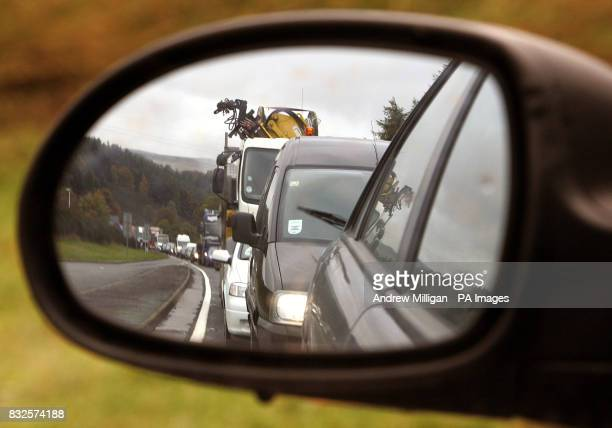 Pictured is a traffic jam pictured in the wing mirror of a car on the A9 road in the Highlands in Scotland