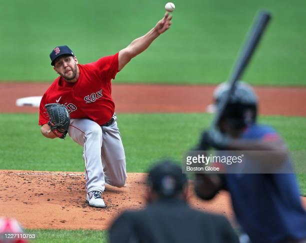 Pictured is Matt Hall pitches to Jackie Bradley, Jr. During a simulated scrimmage with no defenders during Boston Red Sox Summer Camp workouts at...