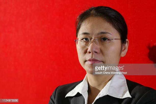 Pictured is prison warden Poon Poyee in her work uniform This is for a feature story about the plight of prison wardens They are under a lot of work...