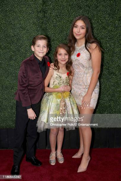 Jacob Tremblay Erica Tremblay and Emma Tremblay arrive to the 2019 E People's Choice Awards held at the Barker Hangar on November 10 2019 NUP_188992