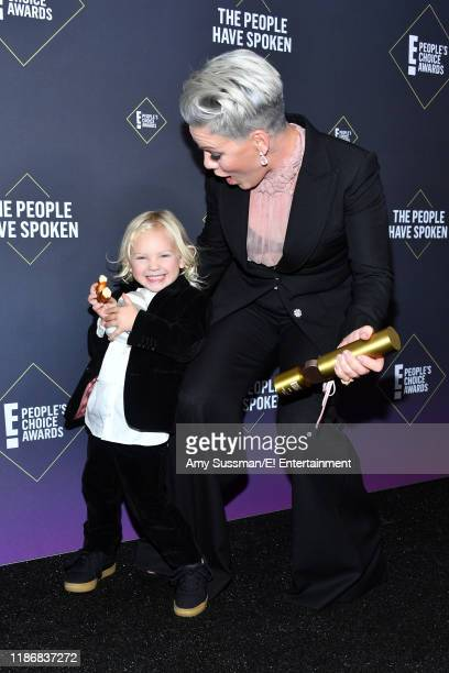 Jameson Hart and Pink winner of People's Champion Award of 2019 award pose in the press room during the 2019 E People's Choice Awards held at the...