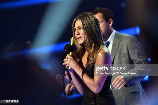 Jennifer Aniston receives the People's Icon award on stage during the 2019 E People's Choice Awards held at the Barker Hangar on November 10 2019...