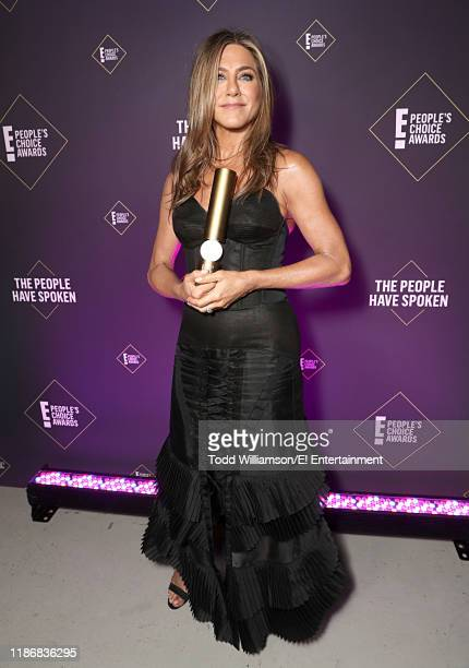 Pictured: Jennifer Aniston, winner of the People's Icon award poses backstage during the 2019 E! People's Choice Awards held at the Barker Hangar on...
