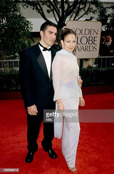 Jennifer Lopez arrives with guest at the 55th Annual Golden Globe Awards held at the Beverly Hilton Hotel on January 18 1998