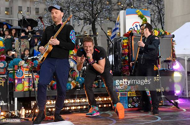 Jonny Buckland Chris Martin Guy Berryman of Coldplay perform on the Today show on Monday March 14 2016 from Rockefeller Plaza in New York