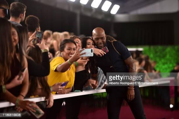 Karamo Brown arrives to the 2019 E People's Choice Awards held at the Barker Hangar on November 10 2019 NUP_188996