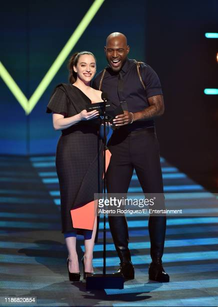 Pictured: Kat Dennings and Karamo Brown speak on stage during the 2019 E! People's Choice Awards held at the Barker Hangar on November 10, 2019 --...