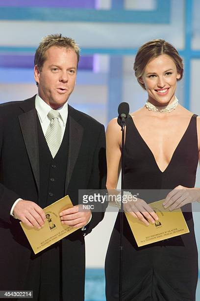 Kiefer Sutherland and Jennifer Garner speak on stage at the 60th Annual Golden Globe Awards held at the Beverly Hilton Hotel on January 19 2003