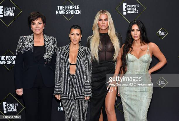 Kris Jenner Kourtney Kardashian Khloé Kardashian and Kim Kardashian West arrive to the 2019 E People's Choice Awards held at the Barker Hangar on...