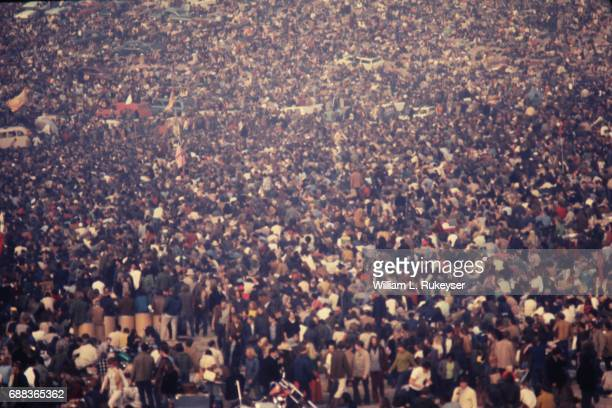 Pictured later in the day the increasingly packed together crowd at the Altamont Speedway for the free concert to be headlined by the Rolling Stones
