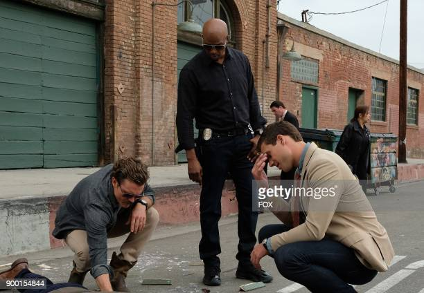 Pictured LR Clayne Crawford Damon Wayans and guest star Andrew Creer in the Funny Money winter premiere episode of LETHAL WEAPON airing Tuesday Jan 2...