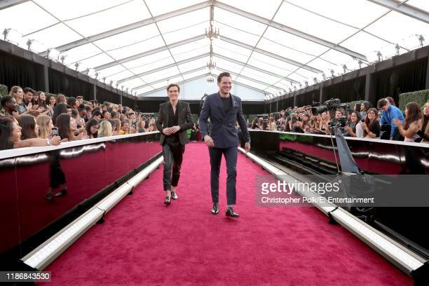 Pictured: Luke Baines and Dominic Sherwood arrive to the 2019 E! People's Choice Awards held at the Barker Hangar on November 10, 2019. -- NUP_188992