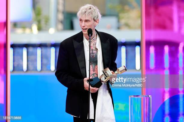 Pictured: Machine Gun Kelly accepts Top Rock Artist on stage during the 2021 Billboard Music Awards held at the Microsoft Theater on May 23, 2021 in...